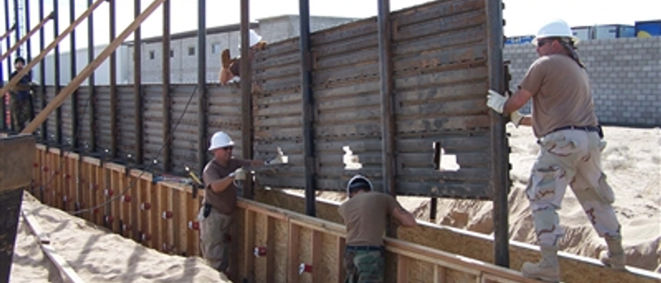 Arkansas National Guard building a wall (Department of Defense photo)