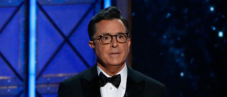 69th Primetime Emmy Awards Show Los Angeles, California, U.S., 17/09/2017 - Host Stephen Colbert holds a book as he speaks during the show. REUTERS/Mario Anzuoni