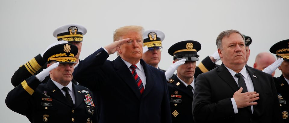 U.S. President Donald Trump salutes as he stands with U.S. Secretary of State Mike Pompeo as a military honor guard carries the remains of Scott Wirtz, a civilian employee of the U.S. Defense Intelligence Agency killed along with three members of the U.S. military during a recent attack in Syria, past during a dignified transfer ceremony at Dover Air Force Base, in Dover, Delaware, U.S., January 19, 2019. REUTERS/Kevin Lamarque