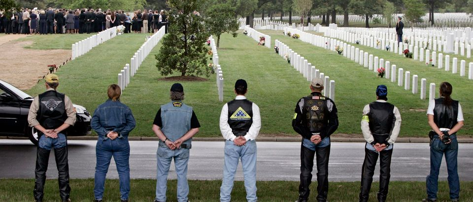 Motorcyclists pay their respects during a funeral at Arlington National Cemetery