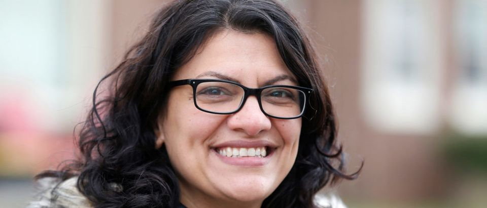 Democratic U.S. congressional candidate Rashida Tlaib canvasses a neighborhood before Election Day in Detroit, Michigan, U.S., Nov. 5, 2018. REUTERS/Rebecca Cook