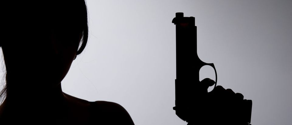 Shutterstock: Woman with gun
