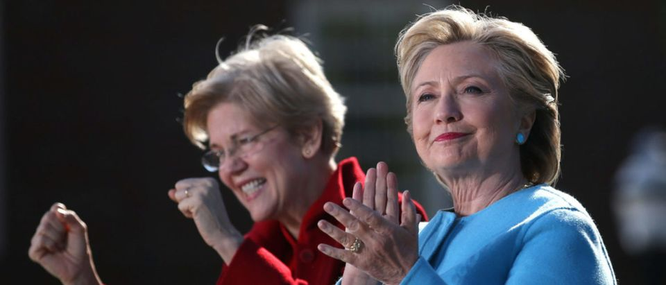 Democratic U.S. presidential nominee Hillary Clinton attends a campaign rally accompanied by U.S. Senator Elizabeth Warren (D-MA) at Alumni Hall Courtyard, Saint Anselm College in Manchester, New Hampshire U.S., October 24, 2016. REUTERS/Carlos Barria