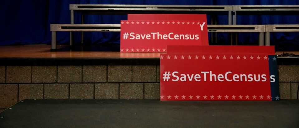 Signs sit behind the podium before the start of a press conference with New York Attorney General Eric Schneiderman to announce a multi-state lawsuit to block the Trump administration from adding a question about citizenship to the 2020 census form. (Drew Angerer/Getty Images)