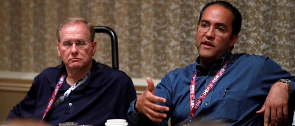 U.S. Congressmen James Langevin (D-RI) and Will Hurd (R-Tex) respond to questions during a session at the Def Con hacker convention in Las Vegas