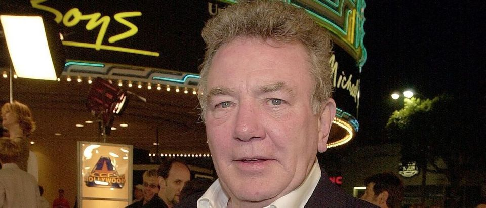 "British actor Albert Finney arrives to the premiere of his new film ""Erin Brockovich"" in Los Angeles, CA 14 March 2000. The film also stars Julia Roberts and is directed by Steven Soderbergh.( Photo credit: LUCY NICHOLSON/AFP/Getty Images)"