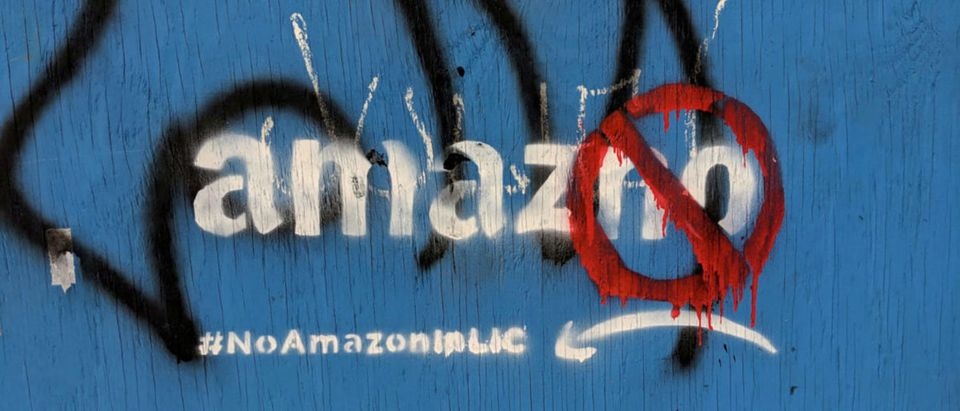 Graffiti opposing the construction of the new Amazon campus covers a fence at a vacant lot in the Long Island City neighborhood of New York City, U.S. REUTERS/Nandita Bose