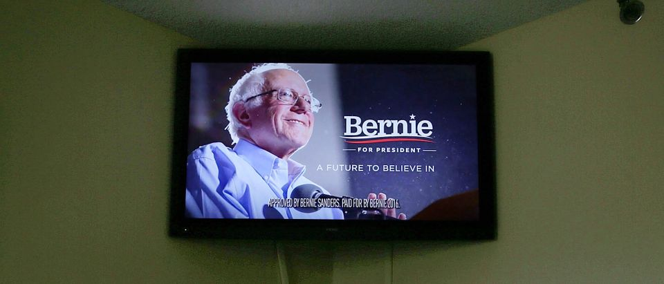 A campaign ad paid for by Democratic presidential candidate Sen. Bernie Sanders' campaign is shown on the TV in a hotel breakfast room November 16, 2015 in Des Moines, Iowa. Iowa will hold its caucus on February 1, 2016, the first in the primary season. (Photo by Alex Wong/Getty Images)