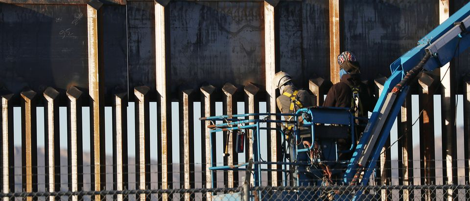 People work on the U.S./ Mexican border wall on February 12, 2019 in El Paso, Texas. (Joe Raedle/Getty Images)