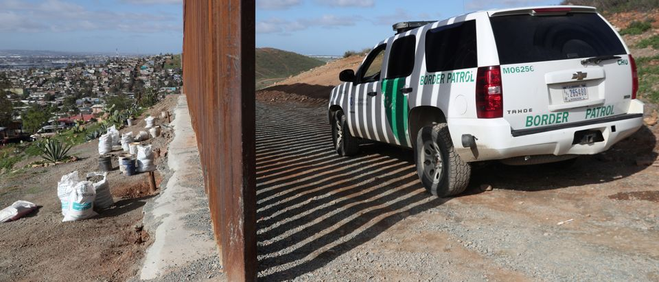 A Border Patrol vehicle is seen next to the U.S. and Mexico border fence after being detained by U.S. Border Patrol in Tijuana, Mexico, January 21, 2019. REUTERS/Shannon Stapleton