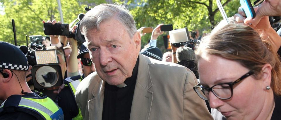 Cardinal George Pell (C) makes his way to the court in Melbourne on February 27, 2019. (CON CHRONIS/AFP/Getty Images)