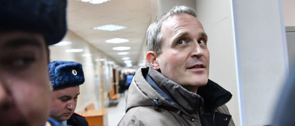 Dennis Christensen is escorted inside a courthouse following the verdict announcement in the town of Oryol on February 6, 2019.(MLADEN ANTONOV/AFP/Getty Images)