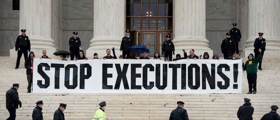 Police officers gather to remove activists during an anti death penalty protest in front of the Supreme Court on January 17, 2017 (Brendan Smialowski/AFP/Getty Images)