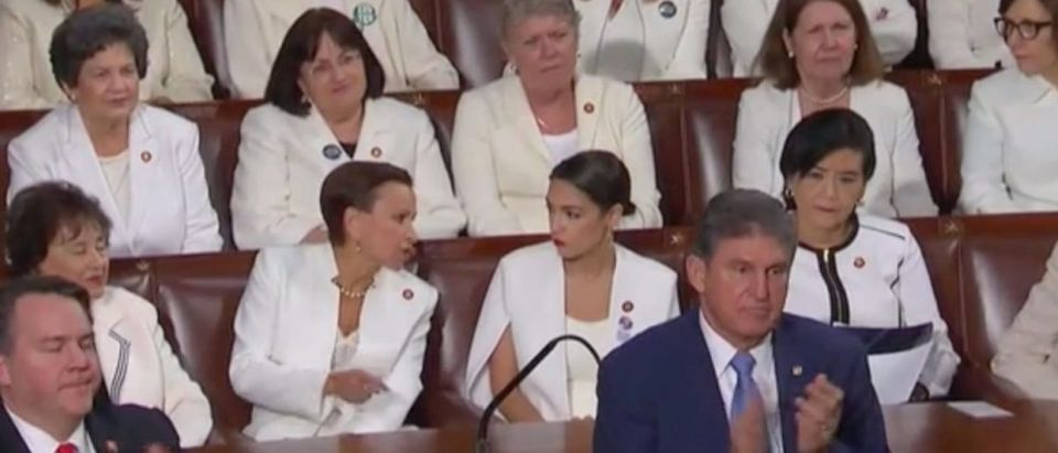 Sen. Joe Manchin stands as most Democrats remain seated during State of the Union call to end abortion once the fetus can feel pain. Screen Shot/Fox News