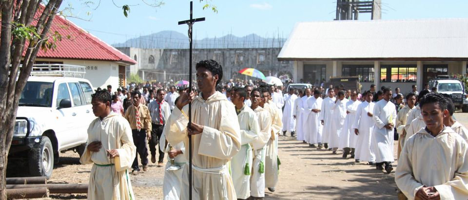 In this photograph taken on Sept. 8, 2009, East Timorese priests and residents hold a procession at the Suai cathedral in the southern city of Suai to mark the 10th anniversary of the Suai church massacre in which 200 civilians were killed. (MATT CROOK/AFP/Getty Images)