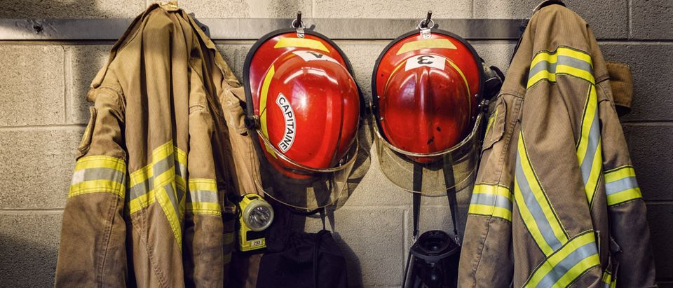 Fire fighter jackets hanging on the wall (Shutterstock/Mat277)