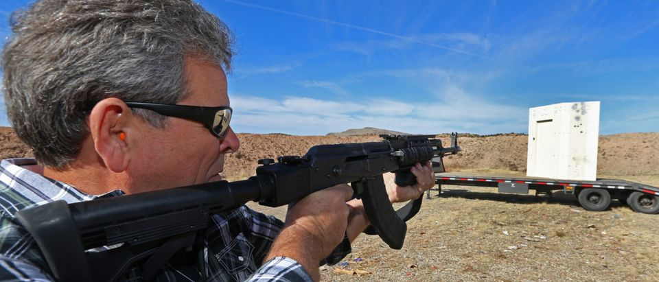 "CEO of ""Shelter in Place"" Jim Haslem, fires an AK-47 assault rifle into one of his bullet resistant shelters on October 25, 2018 in Cedar City, Utah. (Photo by George Frey/Getty Images)"