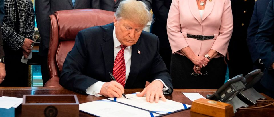 US-POLITICS-SIGNING-TRUMP