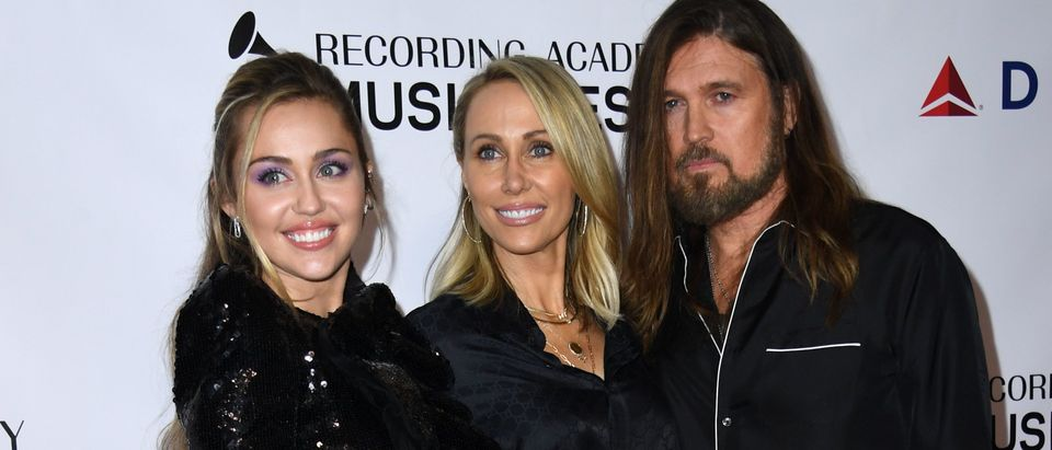 (From L) US singer Miley Cyrus and parents Tish and Billy Ray Cyrus arrive for the 2019 MusiCares Person Of The Year gala at the Los Angeles Convention Center in Los Angeles on February 8, 2019. (Photo by Valerie MACON / AFP) (Photo credit should read VALERIE MACON/AFP/Getty Images)