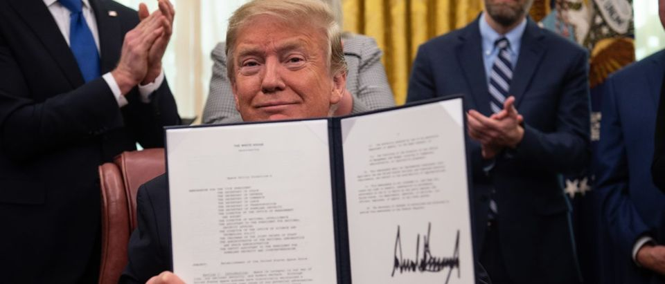 US President Donald Trump shows his signature on the Space Policy Directive-4 (SPD-4) on February 19, 2019, at the White House in Washington, DC. (NICHOLAS KAMM/AFP/Getty Images)