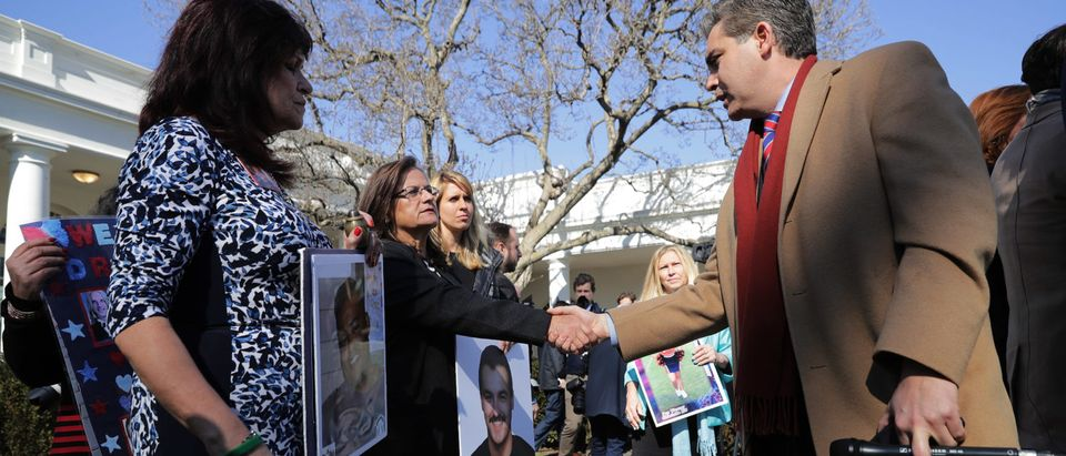 CNN's Jim Acosta (R) greets 'angel moms,' including Agnes Gibboney (C) (Photo by Chip Somodevilla/Getty Images)