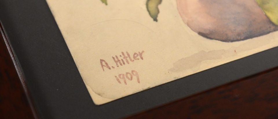 "The signature reading 'A Hitler, 1909' at the watercolour ""Blumenstillleben"" is pictured on June 11, 2015 in the Weidler auction house in Nuremberg, southern Germany. (CHRISTOF STACHE/AFP/Getty Images)"