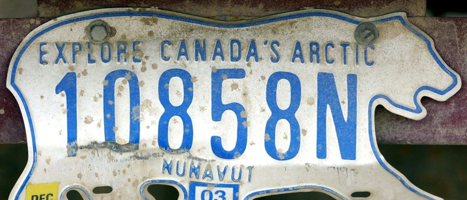 A license plate hangs on a vehicle in Nunavut, Can.