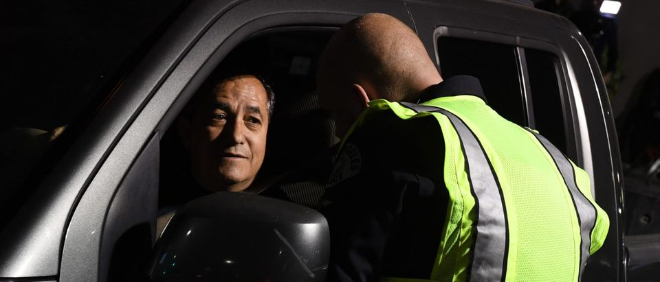 A driver is questioned at a LAPD police DUI checkpoint in Reseda, Los Angeles, California on April 13, 2018. (MARK RALSTON/AFP/Getty Images)