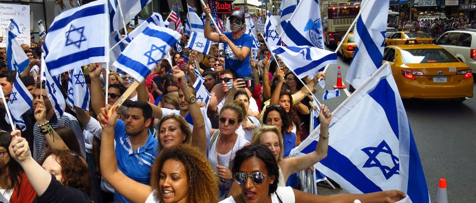 Pro-Israel supporters hold a rally at Times Square in New York, to show support for Israel's military offensive in the Gaza Strip
