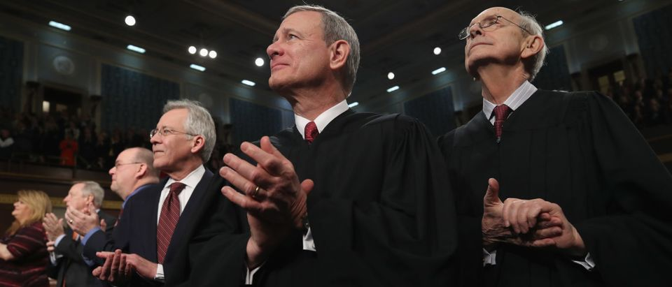 Chief Justice John G. Roberts (C) and Justice Stephen G. Breyer (R) watch during the State of the Union address in the chamber of the U.S. House of Representatives on January 30, 2018 (Win McNamee/Getty Images)