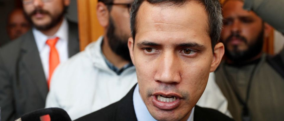 Venezuelan opposition leader and self-proclaimed interim president Juan Guaido talks to the media before a session of the Venezuelas National Assembly in Caracas, Venezuela, Jan. 29, 2019. REUTERS/Carlos Garcia Rawlins
