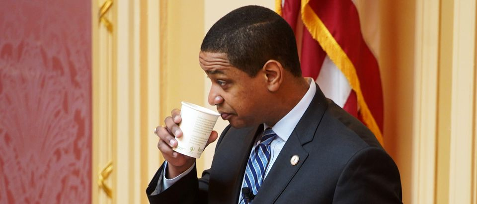 Justin Fairfax, the Lieutenant Governor of Virginia, drinks before opening the state's Senate meeting during a session of the General Assembly in Richmond, Virginia, U.S, February 8, 2019. REUTERS/Jay Paul