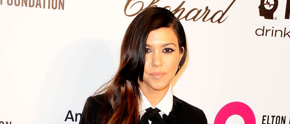 Television personality Kourtney Kardashian arrives at the 2014 Elton John AIDS Foundation Oscar Party in West Hollywood, California March 2, 2014. REUTERS/Gus Ruelas