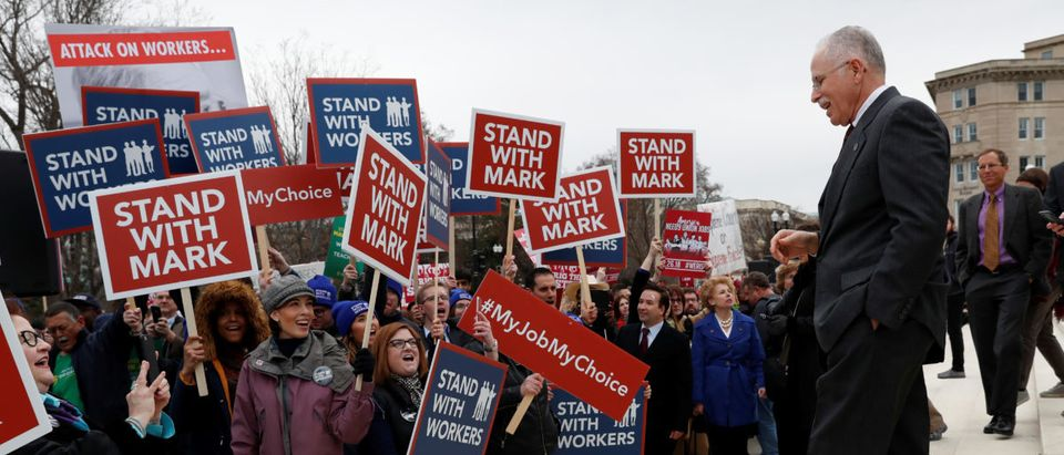 Mark Janus is cheered by supporters outside of the United States Supreme Court in Washington, U.S., February 26, 2018. REUTERS/Leah Millis