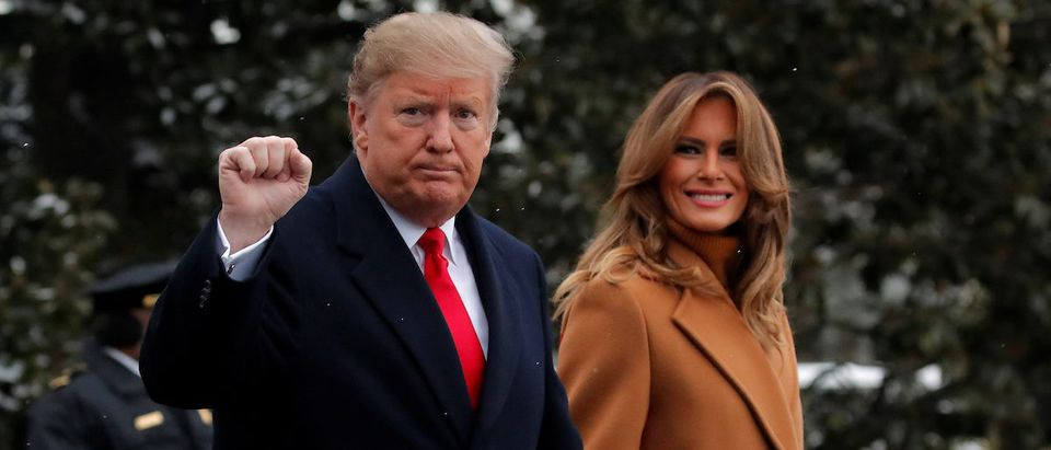 U.S. President Donald Trump walks with first lady Melania Trump while departing for Palm Beach, Florida from the White House in Washington, U.S., February 1, 2019. REUTERS/Jim Young