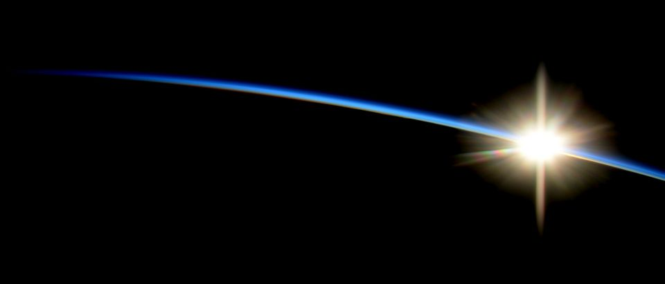 The sun rises over the edge of the earth in an image taken from the International Space Station by NASA astronaut Reid Wiseman