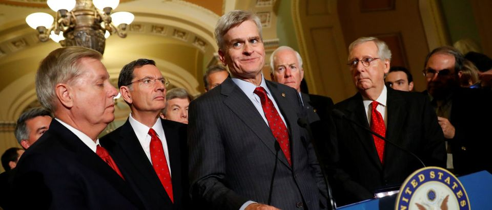Sen. Bill Cassidy, accompanied by (L-R) Sen. Lindsey Graham, Sen. John Barrasso, John Cornyn, and Senate Majority Leader Mitch McConnell, speaks with reporters following the party luncheons on Capitol Hill in Washington, U.S., Sept. 26, 2017. REUTERS/Aaron P. Bernstein