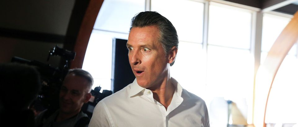 California Democratic gubernatorial candidate Gavin Newsom makes a face while joking around after voting in the midterm elections in Larkspur, California