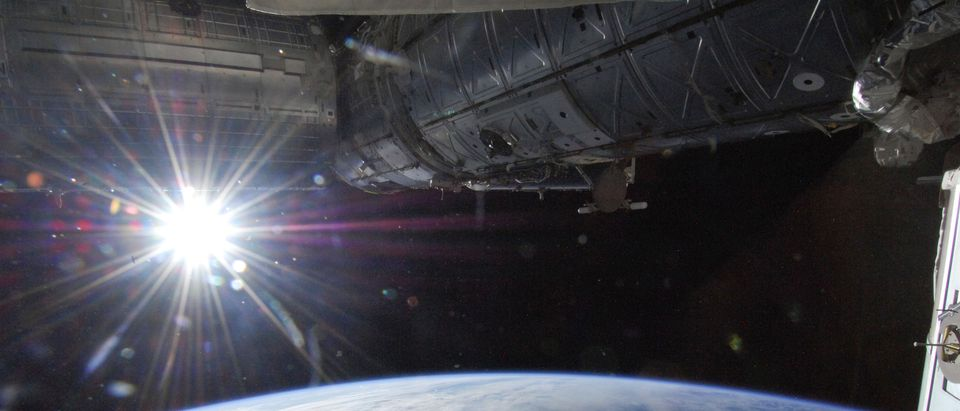 The sun is captured over Earth's horizon by one of the Expedition 36 crew members aboard the International Space Station