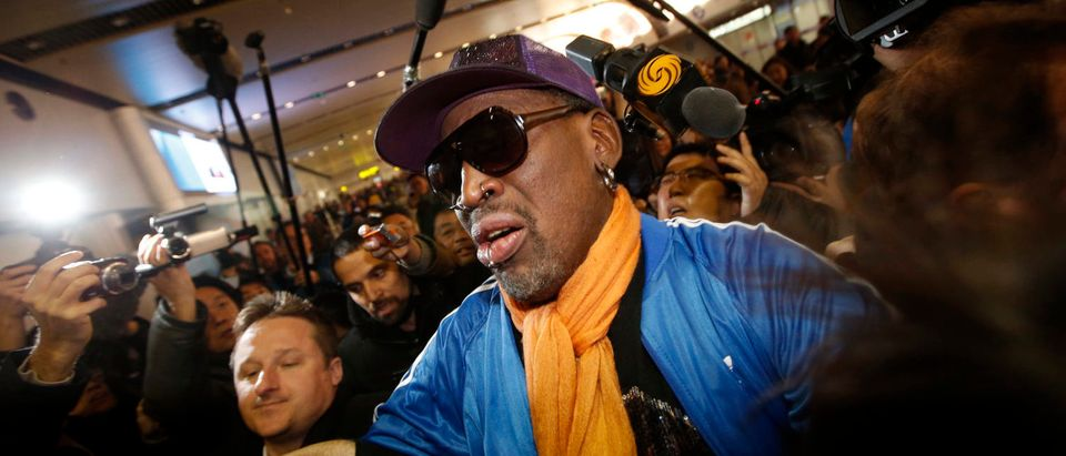 Retired U.S. basketball star Dennis Rodman is surrounded by journalists upon his arrival from North Korea's Pyongyang at Beijing Capital International Airport January 13, 2014. (REUTERS/Kim Kyung-Hoon)