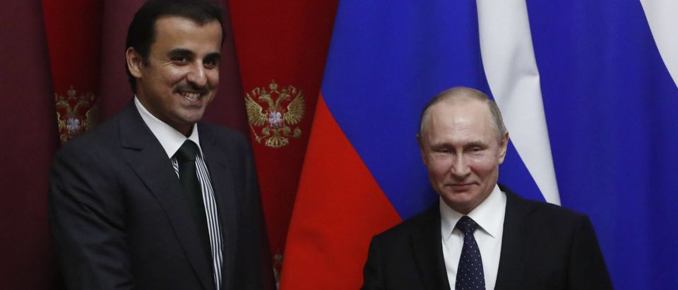 Russian President Vladimir Putin and Qatar's Emir Sheikh Tamim bin Hamad al-Thani shake hands during a signing ceremony following a meeting at the Kremlin in Moscow