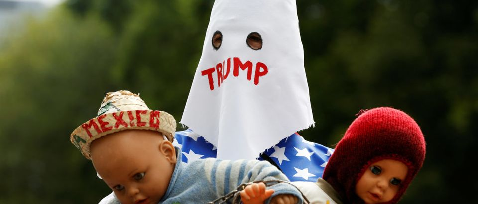 A demonstrator in a KKK hood takes part in a protest against U.S. immigration policies in Mexico City