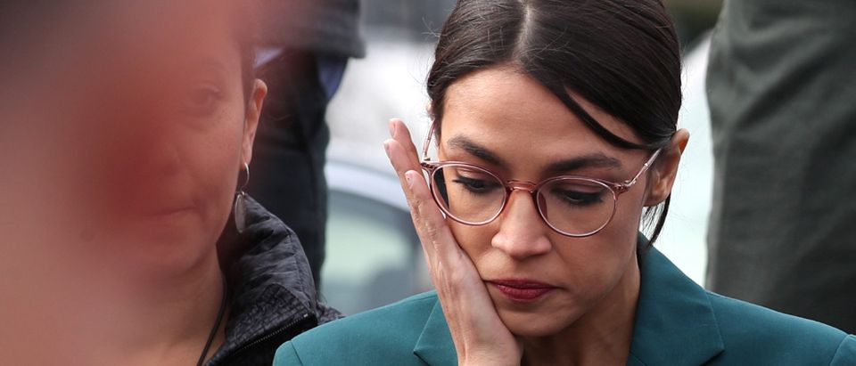 U.S. Representative Alexandria Ocasio-Cortez wipes away tears as Representative Ilhan Omar talks about her own experience as a refugee during a news conference at the U.S. Capitol in Washington