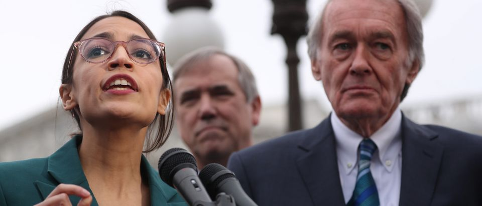 """U.S. Representative Ocasio-Cortez and Senator Markey hold a news conference for their proposed """"Green New Deal"""" to achieve net-zero greenhouse gas emissions in 10 years, at the U.S. Capitol in Washington"""