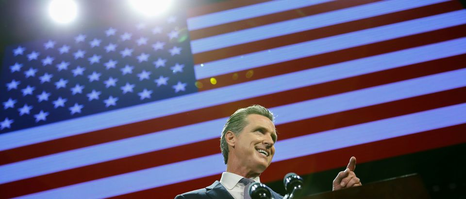 Gavin Newsom speaks after being elected governor of the state during an election night party in Los Angeles, California, U.S. November 6, 2018. REUTERS/Mike Blake.