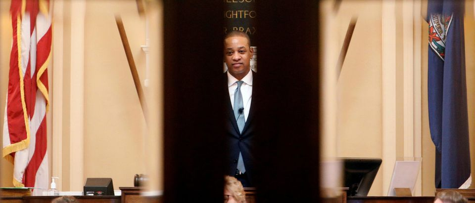Virginia Lieutenant Governor Justin Fairfax is framed by the doors of the state's senate as he presides over it in Richmond