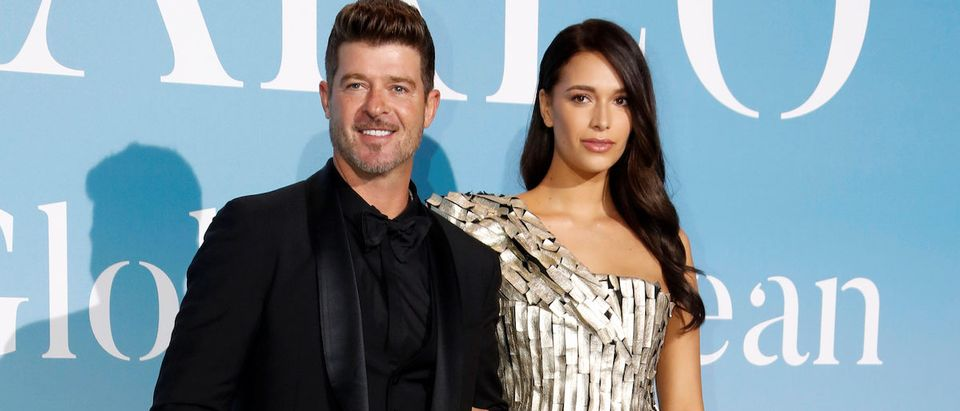 Singer Robin Thicke and April Love arrive for the Monte-Carlo Gala for the Global Ocean in Monaco, September 26, 2018. REUTERS/Eric Gaillard