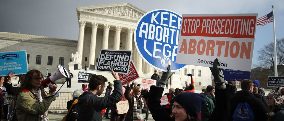 Protesters on both sides of the abortion issue gather in front of the U.S. Supreme Court building during the Right To Life March, on Jan. 18, 2019. (Mark Wilson/Getty Images)