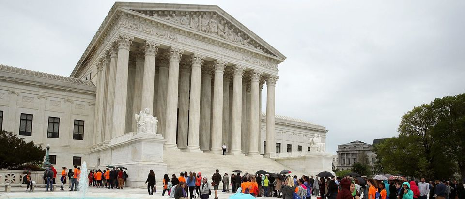 People wait in line to enter the Supreme Court, on April 19, 2017. (Mark Wilson/Getty Images)