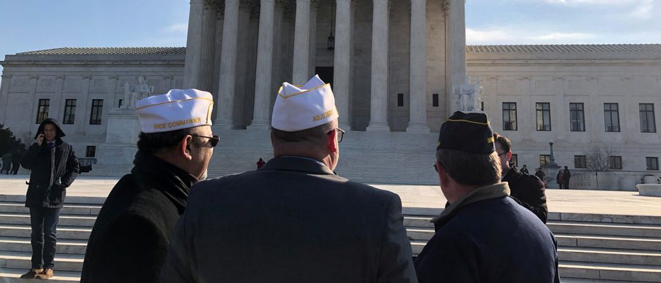 Supporters of a cross, commemorating servicemen killed in World War One in Bladensburg, Maryland, gather outside the U.S. Supreme Court ahead of oral arguments over whether the memorial is an unconstitutional government endorsement of religion, in Washington, DC, U.S., February 27, 2019. REUTERS/Lawrence Hurley